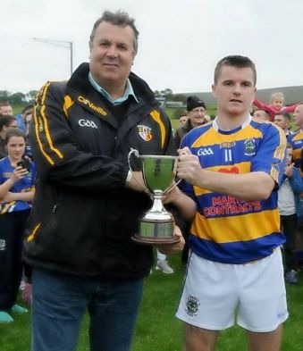 Antrim Chairman Jim Murray presents Declan McKay JHC trophy